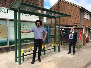 Councillors at the newly installed bus shelter in Royston